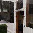 Bache en toile PVC pour la porte d'un petit batiment - toile cristal