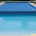 Bâche pour piscine avec enrouleur